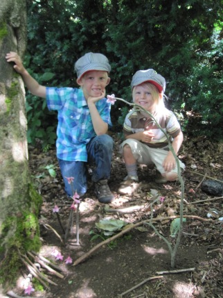 The brothers by their fairy house