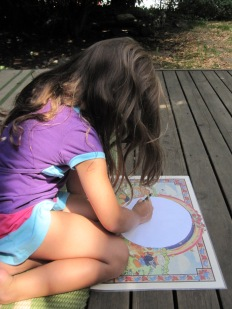 Lucia working on her mandala.
