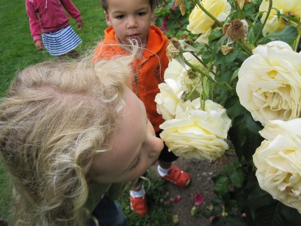 Roan picks a delicious rose to smell.